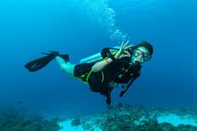 Female Scuba Diver Underwater Showing Ok Signal