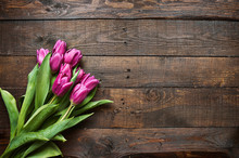 Pink, Tulips Bunch On Dark Barn Wood Planks Background. Space For Text, Copy, Lettering. Postcard Template.
