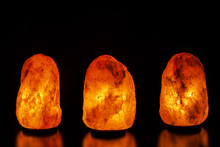 Three Salt Lamps On Black Back...