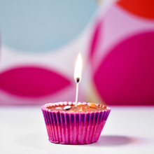 Cupcake Topped With A Lighted ...