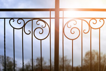 Sunset And Wrought Gate