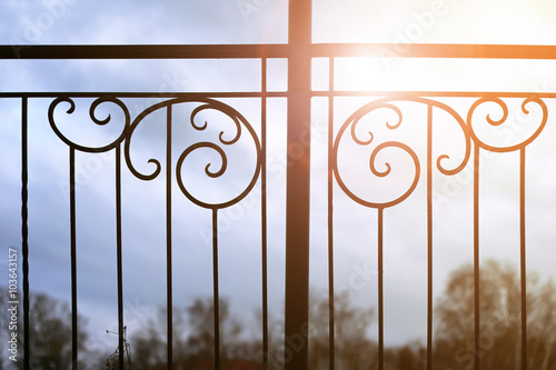 Photo sunset and wrought gate