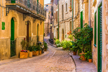 View of an romantic street of a old mediterranean village at Spain