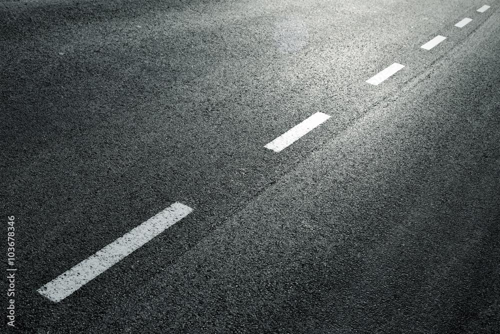 Fototapeta White dotted line on city asphalt road background.