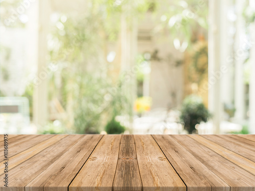 Fototapeta Wooden board empty table in front of blurred background. Perspective brown wood over blur in coffee shop - can be used for display or montage your products.Mock up for display of product. obraz