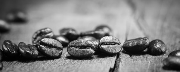 Coffee Beans texture on black and white on the wood background
