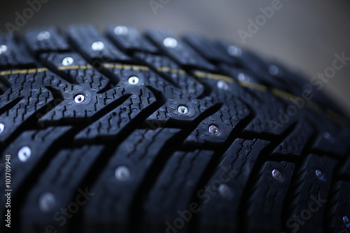 Fotografie, Obraz  Studded tire on a  background