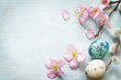 Easter eggs and cherry blossom retro blue background