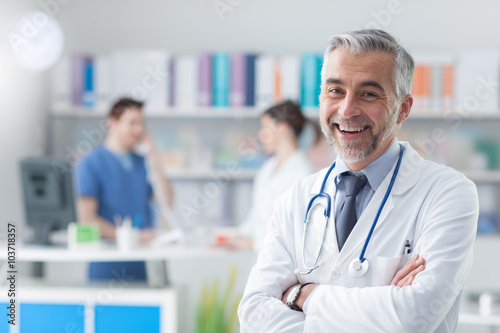 Confident doctor posing in the office Poster