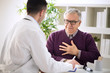 Sick old man visit doctor specialist