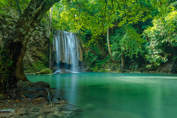 Green nature landscape with turquois waterfall