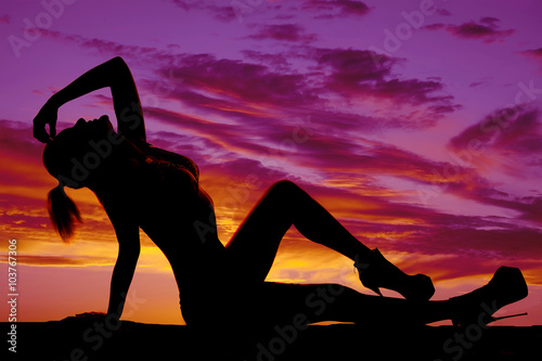Printed kitchen splashbacks Panther silhouette of woman in black and white bikini sit lean back in s