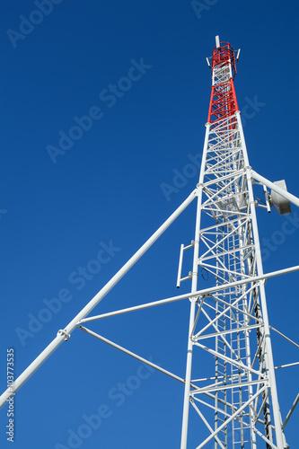 Fotografie, Tablou  telecommunication antenna reaching a deep blue summer sky