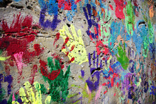 Wall Painted Colorful Background With Printed Hands