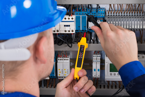 Photo  Male Electrician Checking Fusebox