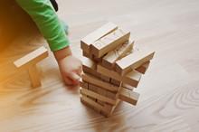 Hand Of Baby Who Played Developmental Game Of Wooden Blocks Lumb