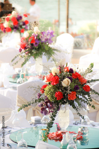 Table Setting With Bouquet Flowers At A Luxury And Elegant Wedding