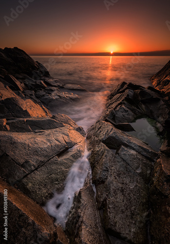 Dawn among the rocks. Sea sunrise at the Black Sea coast near Rezovo, Bulgaria
