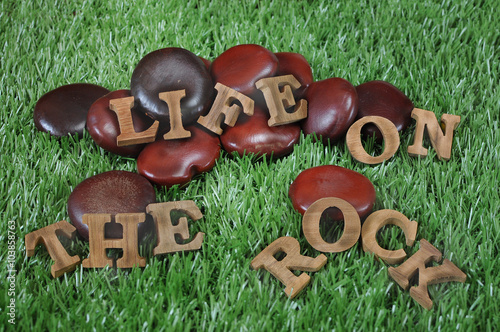 Fotografía  Phase of Life on the rock in wooden design, motivation concept