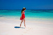 Enjoy life. Beautiful girl jumping running on exotic beach with