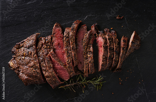 Recess Fitting Steakhouse grilled flat iron steak shot in flat lay style from overhead