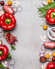 Red Paprika And Diverse Vegetables And Cooking Ingredients On Gray Stone Background, Top View, Frame, Vertical. Vegetarian Food And Healthy Lifestyle Concept.