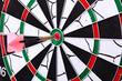 Dart hit the target on dartboard