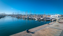 Sail Boats Idle In Ibiza Marina Harbor In The Morning Of A Warm Sunny Day In St Antoni De Portmany Balearic Islands, Spain.