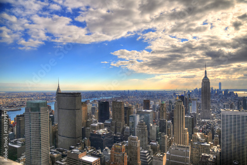Magnificent colorful view of the skyline of New York City with all the famous skyscrapers in high dynamic range (HDR) on cloudy-sunny day