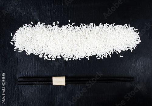 Fotografia  Rice with chopsticks for background