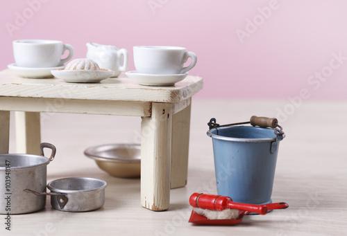 Photo  Vintage dollhouse kitchen equipments