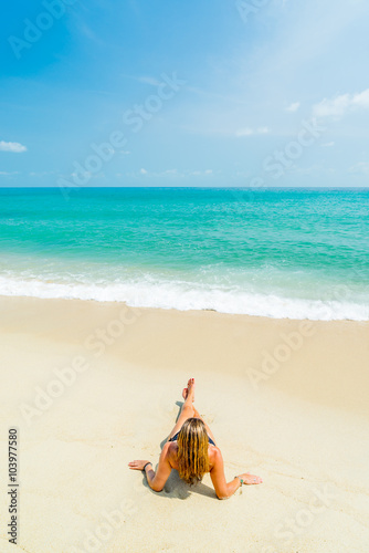 Canvas Prints Textures Woman suntanning on the beach on the tropical beach