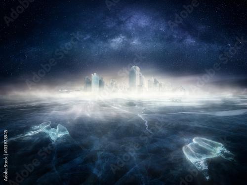 Fotografie, Obraz  Frozen city in icy landscape under the night sky