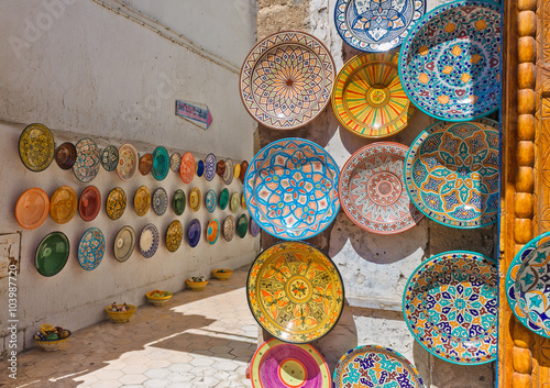 Traditional colorful Moroccan plates on the street walls of Marrakesh.