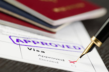 Visa Application Approved, Close Up Shot Of A Form, Passports And Pen.