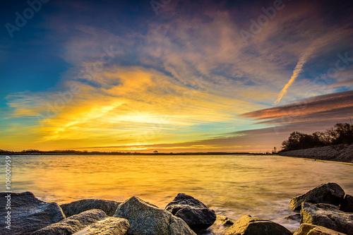 fototapeta na szkło Wschód słońca nad morzem