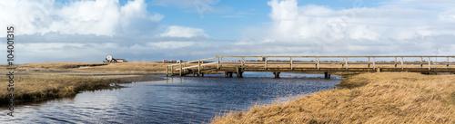 Spoed Foto op Canvas Noordzee Panorama Holzbrücke an der Nordsee
