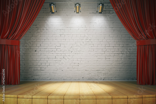 Wooden stage with red curtains and a white brick wall with spotl Fototapeta