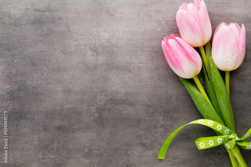 Foto op Aluminium Bloemen Tulip on the grey background.