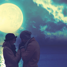 Silhouettes Of A Couple With Lunar Background.