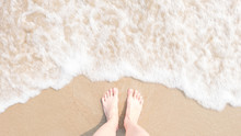 Top View Foot On The Beach With Blur And Soften Sea Foam, Hipster Style