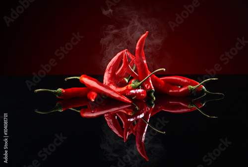Staande foto Hot chili peppers beam of red chilli pepper