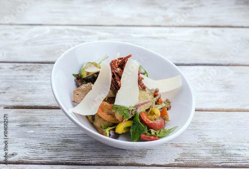 Foto op Plexiglas Klaar gerecht meat salad with parmesan