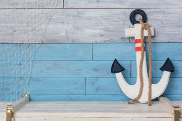 Naklejkaanchor on wood background blue and white