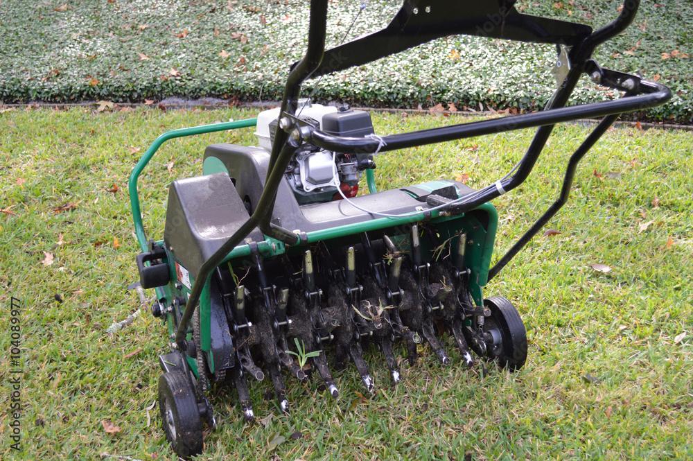 Valokuva Lawn aeration machine with grass plug stuck in the stem