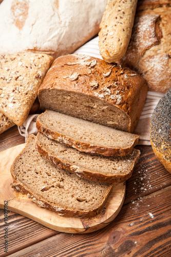 Foto op Plexiglas Brood Bread assortment on wooden surface