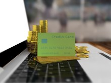 Credit Gold Card On A Laptop. Blur Background