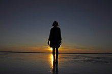 A Girl Stands On Frozen Ice La...