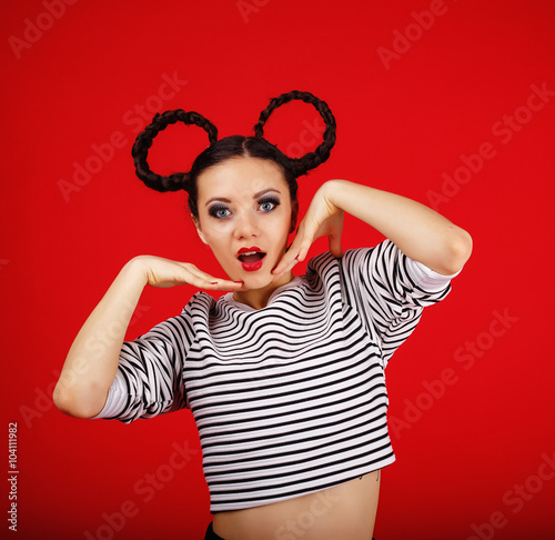 Photo  High fashion girl with unusual hairstyle like Minnie Mouse in the studio