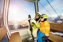 Mom Talk To Child Sitting In Ski Lift Cabin